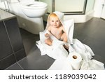 toddler ripping up toilet paper ... | Shutterstock . vector #1189039042