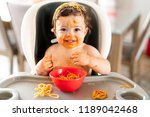 child girl  eating spaghetti... | Shutterstock . vector #1189042468