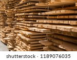piles of wooden boards in the... | Shutterstock . vector #1189076035