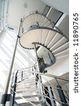 Metal spiral staircase in modern building - stock photo