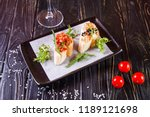 bruschetta with black caviar... | Shutterstock . vector #1189121698