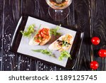 bruschetta with black caviar... | Shutterstock . vector #1189125745