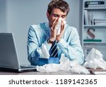 sick worker blow his nose in... | Shutterstock . vector #1189142365