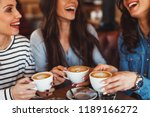 three young women enjoy coffee...