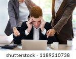 stressed caucasian businessman... | Shutterstock . vector #1189210738