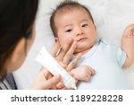 mother is applying cream to the ... | Shutterstock . vector #1189228228