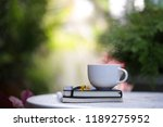 white cup with yellow flowers... | Shutterstock . vector #1189275952