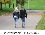 young man and girl walking on... | Shutterstock . vector #1189360222