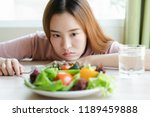 unhappy asian women is on... | Shutterstock . vector #1189459888