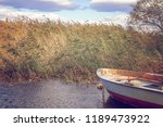 small boat in the creek | Shutterstock . vector #1189473922