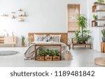 bed with wooden headboard in... | Shutterstock . vector #1189481842