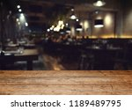 wood table on blur of cafe ... | Shutterstock . vector #1189489795