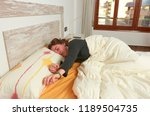 woman stretching in bed after...   Shutterstock . vector #1189504735