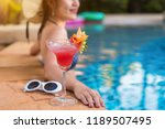 bikini woman in pool relaxing... | Shutterstock . vector #1189507495