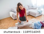 happy woman housewife ironing... | Shutterstock . vector #1189516045
