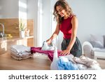 happy woman housewife ironing... | Shutterstock . vector #1189516072