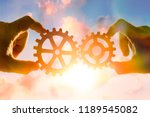 two hands connect the gears ... | Shutterstock . vector #1189545082