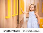 smiling adorable kid opening... | Shutterstock . vector #1189563868