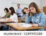 smiling schoolgirl is learning... | Shutterstock . vector #1189592188