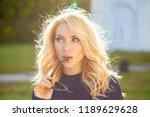 young blonde woman with a... | Shutterstock . vector #1189629628