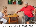 disabled senior and his... | Shutterstock . vector #1189671808