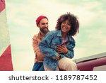 holding. cheerful joyful young... | Shutterstock . vector #1189787452