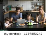 parents using laptop and... | Shutterstock . vector #1189853242