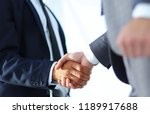 friendly smiling businessmen... | Shutterstock . vector #1189917688