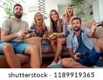 excited friends playing video... | Shutterstock . vector #1189919365