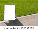 empty metallic board next to a... | Shutterstock . vector #118992022
