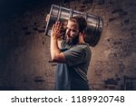 brewer in apron holds barrel... | Shutterstock . vector #1189920748