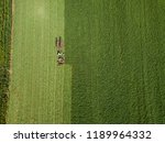 Small photo of Amish Farmer and his two horse team plow their fields of corn and other vegetables