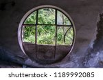 large round window in an old... | Shutterstock . vector #1189992085