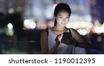woman use of mobile phone in... | Shutterstock . vector #1190012395
