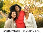 happy group of women laughing. | Shutterstock . vector #1190049178