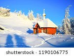 snow covered church in winter... | Shutterstock . vector #1190106775
