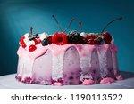 fruit yoghurt cake on a blue... | Shutterstock . vector #1190113522