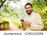 handsome indian bearded man... | Shutterstock . vector #1190123398