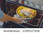 cook putting raw chicken with... | Shutterstock . vector #1190127328
