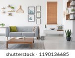 wooden table in front of grey... | Shutterstock . vector #1190136685