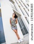beautiful young woman standing... | Shutterstock . vector #1190148385
