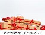 christmas gift box on tablet   Shutterstock . vector #1190162728