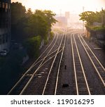 Train Tracks At Dawn In Wester...