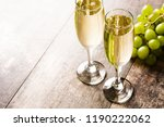 champagne glasses on wooden... | Shutterstock . vector #1190222062