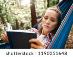 woman relaxing on hammock and... | Shutterstock . vector #1190251648