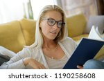 middle aged woman at home... | Shutterstock . vector #1190258608