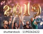 a group of merry young people... | Shutterstock . vector #1190262622