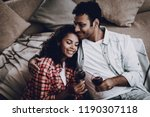 afro american couple drinking... | Shutterstock . vector #1190307118