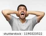 young man shouting while... | Shutterstock . vector #1190323522