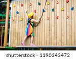 child in forest adventure park. ... | Shutterstock . vector #1190343472